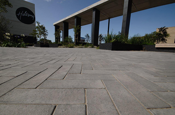Revelstones Cast-Stone Cobbles Complement New Century City Parkade