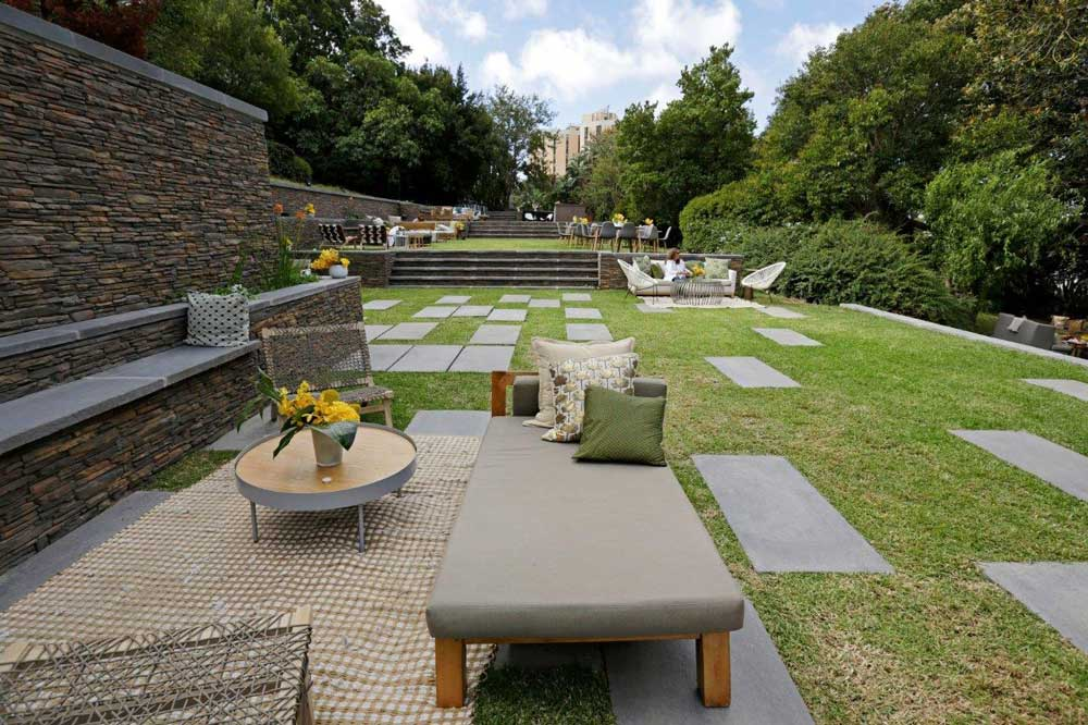 Garden furniture blends in perfectly with the newly created terrace garden in preparation for the Rolex Arts Weekend.